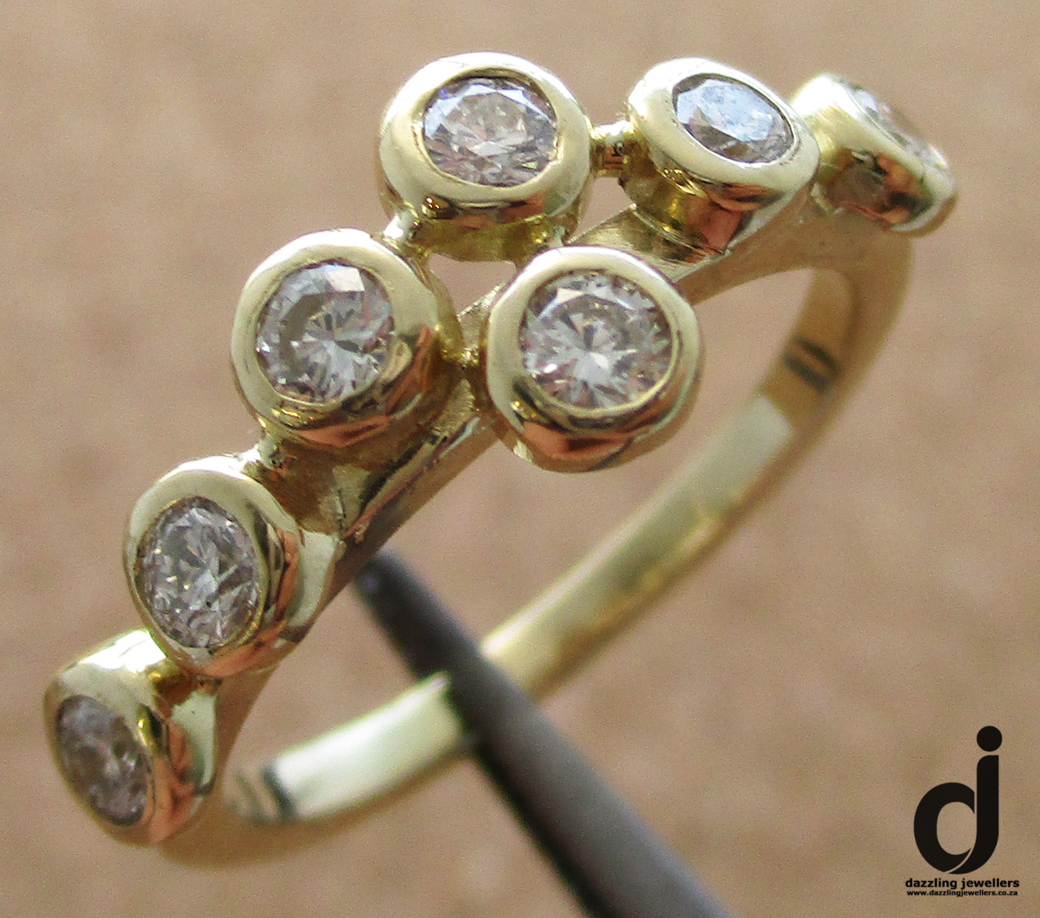 yellow gold and diamnd ring made by dazzling jewellers