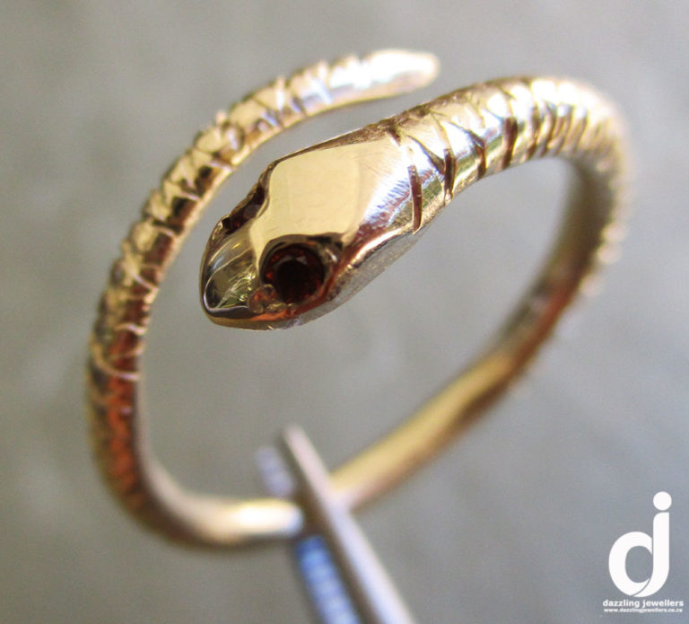 snake ring set with gemstones by dazzling jewellers